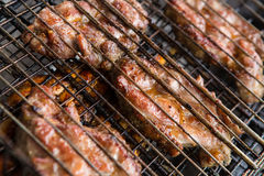 Pieces meat char-grilled over flame Stock Photos