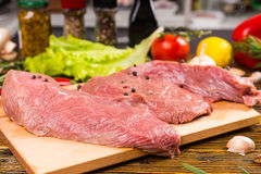 Pieces of meat on cutting board Stock Photography