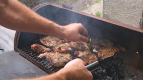 Pieces of meat on the grill stock video footage