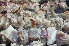 Pieces of meat lie on the fire, the process of cooking shish kebab. Close-up Royalty Free Stock Images