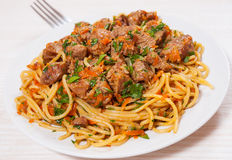 Pieces of meat and vegetables with spaghetti Royalty Free Stock Photos