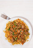 Pieces of meat and vegetables with spaghetti Royalty Free Stock Images