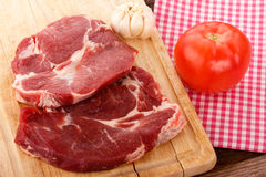 Pieces of meat on a wooden cutting board Stock Photos