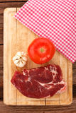 Pieces of meat on a wooden cutting board Royalty Free Stock Image