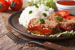 Pieces of meatloaf and rice on a plate close-up, horizontal Royalty Free Stock Photos