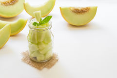 Pieces of melon in a jar. Stock Photos