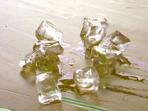 Pieces of melting ice on the table. Pieces of melting ice from the refrigerator Kazan Russia Stock Images