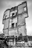 Pieces of Metal and Stone are Crumbling from Demolished Building Royalty Free Stock Photos