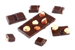 Pieces of milk chocolate bar with nuts Royalty Free Stock Photos