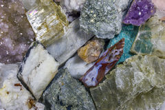 Pieces of minerals. Crystals of mica, quartz, amethyst, pyrite, royalty free stock photography