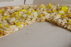 Pizza. Pieces missing from a pinneapple and banana pepper pizza Stock Photos