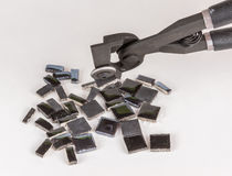 Pieces of mosaic tile with nipper Stock Photos