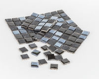 Pieces of mosaic tile. S on white background stock photography
