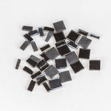 Pieces of mosaic tile. S on white background stock image