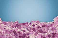 Pieces of natural amethyst over blue vanilla background royalty free stock image
