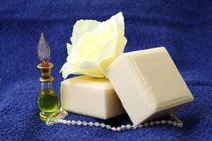 Pieces of natural soap with oil and rose Royalty Free Stock Photo