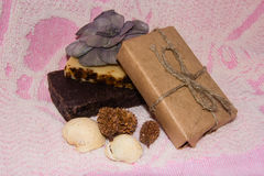 Pieces of natural soap on a towel. Composition Stock Photo