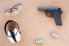 Pieces Of Non Assembled Pistol On Terrazzo Floor Royalty Free Stock Photos