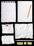 Pieces of notepaper. Isolated on black background stock photography