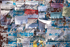 Pieces of old ads. Wall with pieces of old ads, whole screen stock image