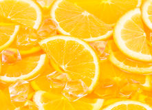 Pieces of orange in juice Royalty Free Stock Photos