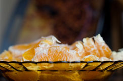 Pieces of orange in a plate. Pieces of fresh orange fruit in a plate Royalty Free Stock Photo