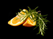 Pieces of orange and rosemary Royalty Free Stock Photography