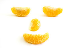 Pieces of orange setting to human face Royalty Free Stock Photography