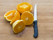 Pieces of Oranges in Cutting Board Stock Image