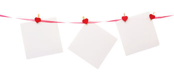 Pieces of paper with heart shaped clothespin Royalty Free Stock Images