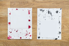 Pieces of paper with ink drops Stock Photo