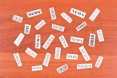 Pieces of paper with inscription NEWS Stock Photography