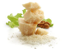 Pieces of parmesan. Some pieces of hard cheese with lettuce and walnut Royalty Free Stock Images