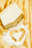 Pieces of parmigiano reggiano or parmesan cheese on wood board Royalty Free Stock Photos