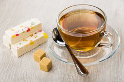 Pieces of pastila with marmalade, lumpy sugar, teaspoon and tea Royalty Free Stock Photography