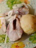 Pieces of pickled herring with onions and potatoes. Close-up stock image
