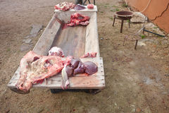 Pieces of pig over wooden trough Royalty Free Stock Photos