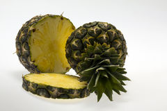 Pieces of pineapple on white backround Stock Photo