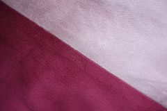 Pieces of pink and red artificial suede sewn together diagonally. Pieces of pink and red artificial suede fabrics sewn together diagonally Royalty Free Stock Photo