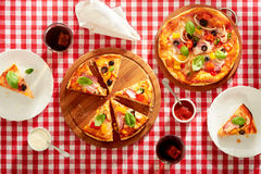 Pieces of pizza on the table. Top view stock images