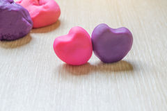 pieces of plasticine on wooden background. Royalty Free Stock Photography
