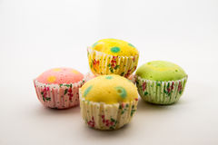 5 pieces of Polka dot cup cake on isolated background. 5 pieces of Polka-dot cup cake isolated background with yellow,red and green colors Stock Photo