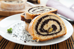 Pieces of poppy seed cake on a plate Stock Photography