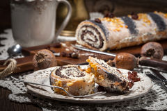 Pieces of poppy seed cake on a plate. Royalty Free Stock Photos