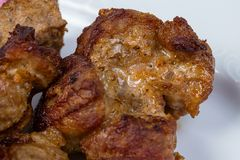 Pieces of pork barbecue, close up photo. On white background Stock Photography