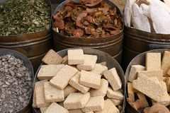 Pieces of pumice stone on the marketplace, Morocco. Spices and other items on the marketplace. Closest in the view is pieces of pumice stone Royalty Free Stock Photography