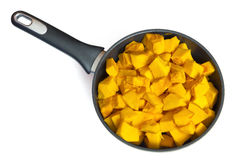 Pieces of pumpkin in a frying pan stock afbeelding