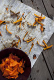 Pieces of pumpkin with peel baked on baking paper Royalty Free Stock Images