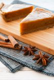 Pieces of pumpkin pie with spices Stock Images