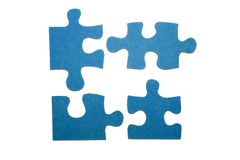 Pieces of a puzzle 1. Four blue pieces of a puzzle with a white background Stock Photos